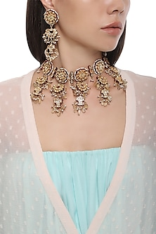 Gold Plated Kundan and Red Meena Necklace with Earrings by HEMA KHASTURI LABEL