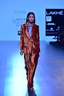 Rust retro wide lapel jacket and trouser pants set by Huemn