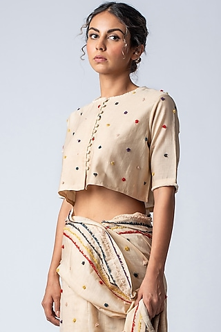 Beige Embroidered Blouse WIth Pom Poms by ILk by Shikha and Vinita