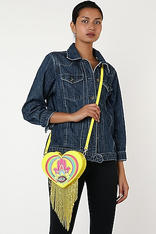 Yellow Rexine Heart Shaped Bag by Manish Arora