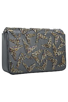 Metallic Grey Embellished Flapover Clutch by Inayat