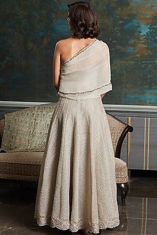 Ivory One-Shouldered Gown With Thread Work by Jade by Monica and Karishma