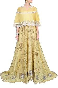 Yellow Floral Printed Skirt And Lace Embroidered Cape Top by Jade by Monica and Karishma