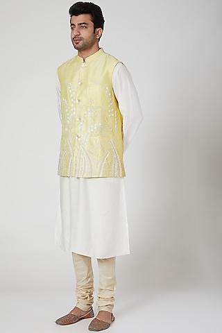 Yellow Embroidered Bundi Jacket by Jenjum Gadi