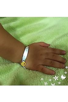White Finish Smiley Bracelet Rakhi by JewelitbySZ