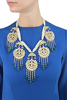Gold finish crescent motif hanging pearl string necklace by Just Shraddha