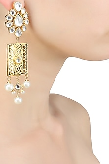 Gold finish long flower studded hanging earrings by Just Shraddha