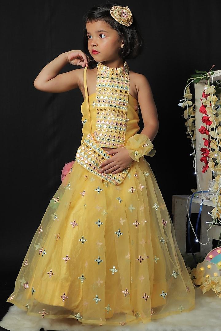 Yellow Net Lehenga Set by  Kirti Agarwal Pret n Couture