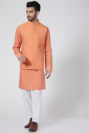 Peach Textured Bundi Jacket With Kurta Set by Kunal Anil Tanna