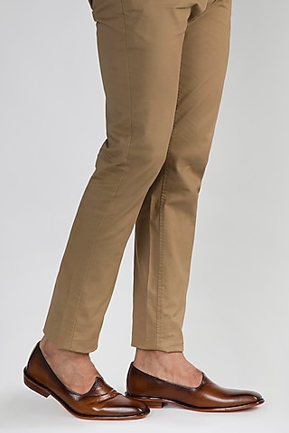 Brown Juttis With Burnish Look by Kavith