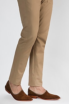 Brown Juttis With Metal Zip Cap by Kavith