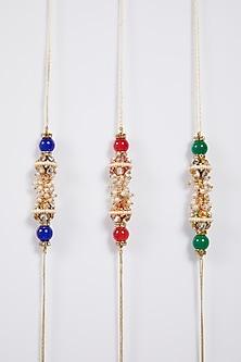 Red, Green, & Blue Rakhi Set by Kara Viyad-SEND RAKHIS TO SINGAPORE