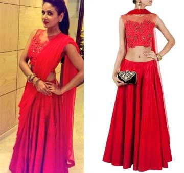 Red lehnga with sheer embroidered blouse by Ridhi Mehra