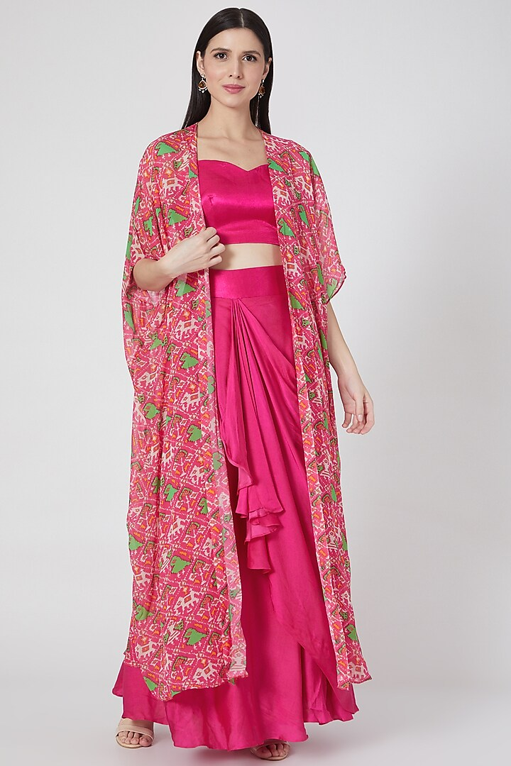 Fuchsia Draped Skirt Set With Printed Cape by Komal Shah