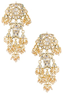Gold plated kundan and pearl long earrings by Just Shraddha