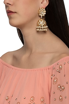Gold plated floral jhumki earrings by Just Shraddha