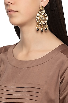 Gold plated round kundan earrings by Just Shraddha