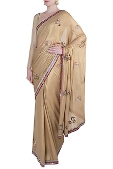 Gold embroidered saree by Kotwara by Meera and Muzaffar Ali