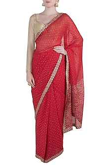 Red embroidered saree by Kotwara by Meera and Muzaffar Ali