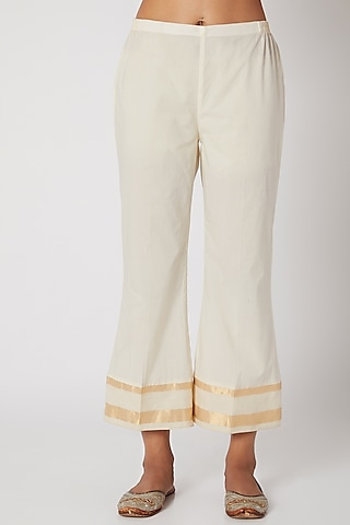 Ecru White Pants With Gold Border by Krishna Mehta