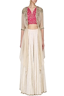 Ivory skirt with pink crop top and beige cover-up set by Kudi Pataka Designs