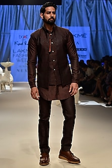 Wine Textured Bundi Jacket by Kunal Rawal
