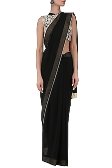 Black saree with embroidered blouse by Kavya Chandra