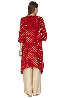 Red Embroidered Dip-Hem Bandhani Kurta With Beige Gold Pants by Kunza