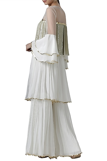 Ivory embroidered blouse with palazzo pants by Limerick By Abirr N' Nanki