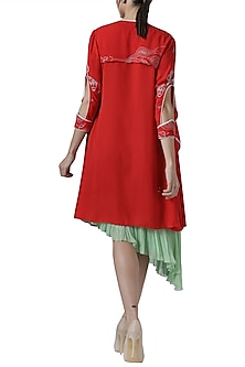 Green asymmetrical tunic with red embroidered jacket by Limerick By Abirr N' Nanki