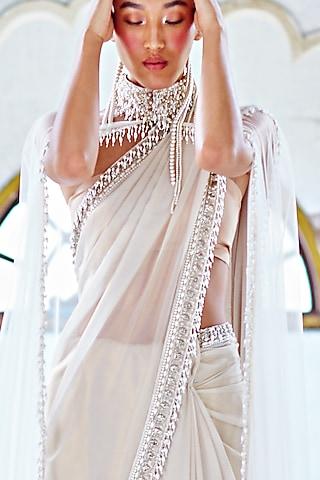 White Saree Set With Hand Work by Mala and Kinnary