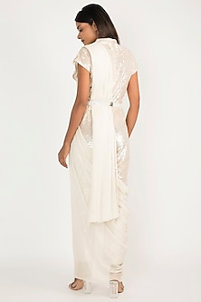 Ivory Embroidered Jumpsuit With Drape & Belt by Manish Malhotra