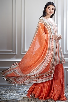 Ivory & Coral Sharara Set With Mirror Embellishments by Mandira Wirk