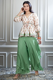 Ivory Printed Top With Green Sharara Pants by Mandira Wirk