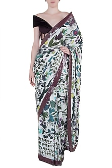 Ivory printed and sequins sheeted saree with blouse piece by Manish Malhotra