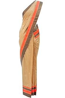 Dull gold sari with orange border by Mandira Bedi