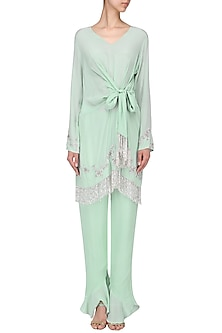 Pista green bow-tie tunic with ruffled pants by Mani Bhatia