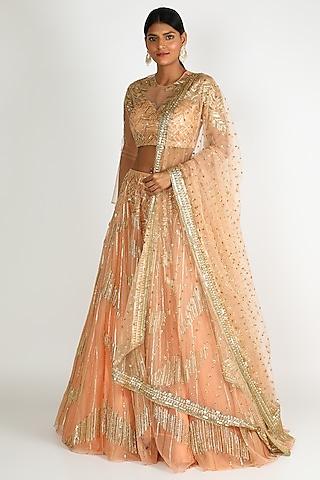 Peach embroidered lehenga set by Megha & Jigar