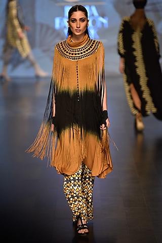 Mustard twiight fringe cape and Healing Jumpsuit by Malini Ramani