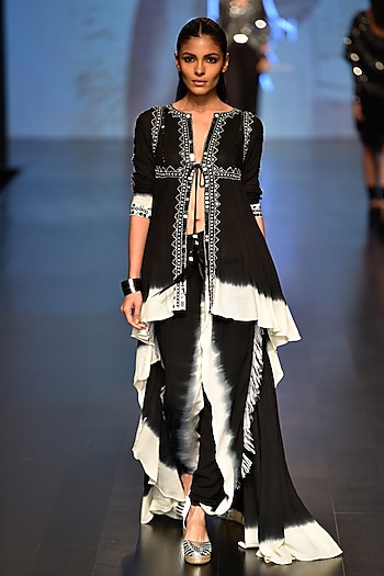 Black and white asymmetric tie-dye tunic and dip deyed pants by Malini Ramani