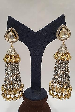 Gold Finish Kundan Stud Earrings by Moh-Maya By Disha Khatri