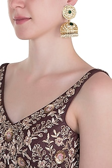 Gold plated long emerald jhumki earrings by MOH-MAYA BY DISHA KHATRI