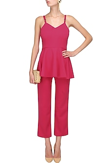 Pink cutout back peplum jumpsuit by Manika Nanda
