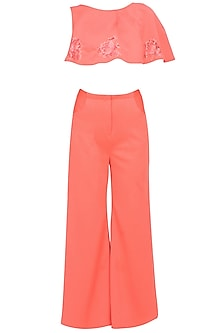 Peach amber overaly crop top and flared pants set by Manika Nanda