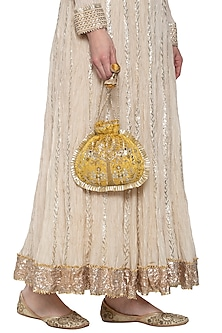 Ochre gold embroidered potli by MKNY