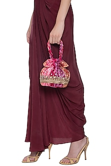Pink multicolored embroidered potli by MKNY