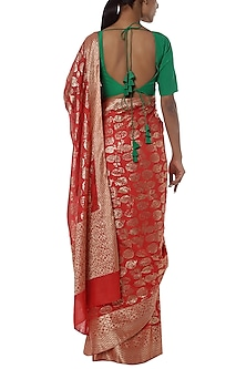 Red printed banarasi saree with green blouse piece by Masaba