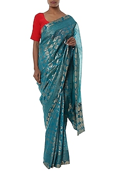 Teal blue printed banarasi saree with red blouse piece by Masaba