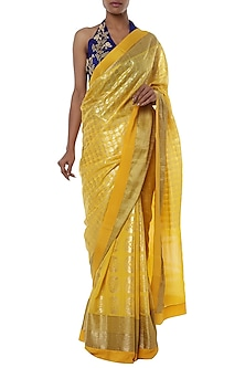 Yellow printed saree with blue blouse piece by Masaba