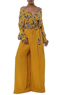 Yellow printed wrap top with palazzo pants by Masaba